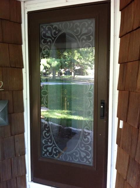 A glass door in front of a wooden door