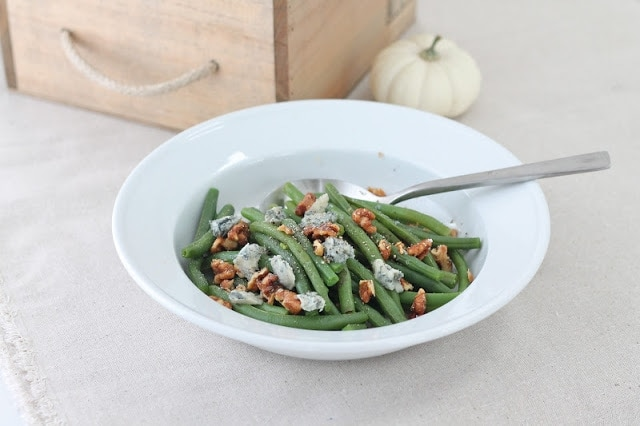 Gorgonzola green beans in a white bowl with a spoon