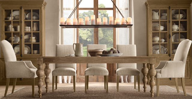 wood table with linen chairs and candle chandelier overhead