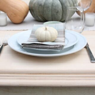 diy farmhouse table with place setting and fall decorations