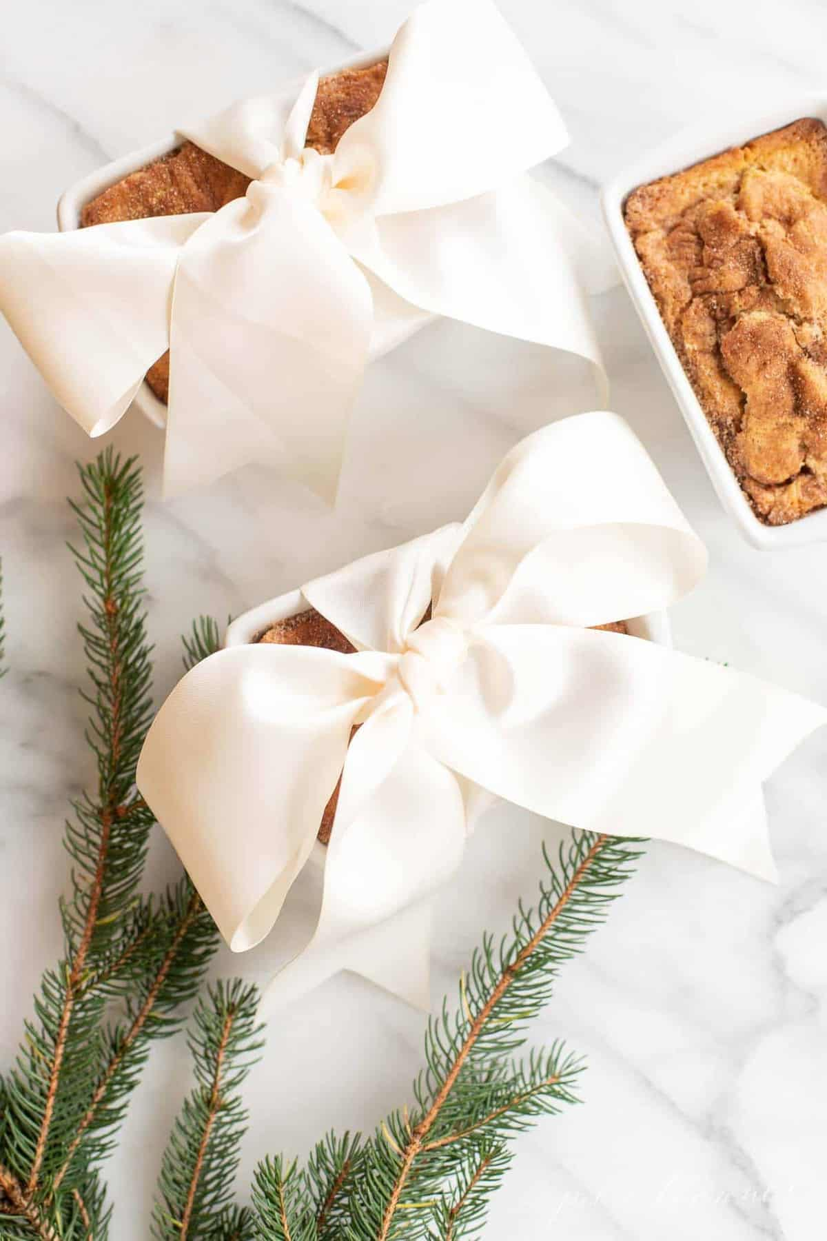 christmas greenery by wrapped bread loaves