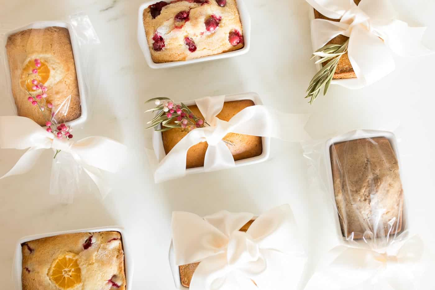 7 different christmas bread loaves wrapped for gifting