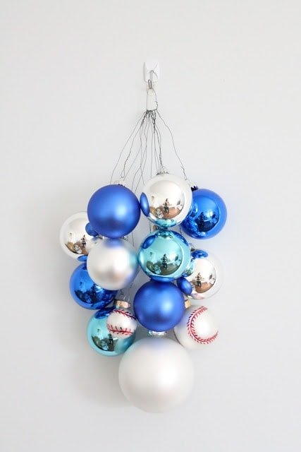 Blue, silver, and baseball ornaments hanging on the wall.