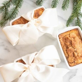 3 cinnamon bread loaves 2 gift wrapped in a bow by christmas greenery