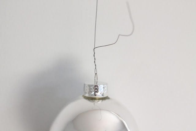 A silver ornament hanging on the wall