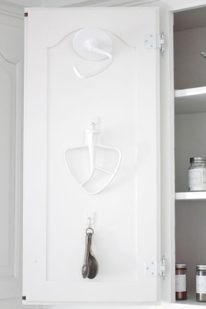 kitchen storage tips using command hooks to maximize space in a cabinet