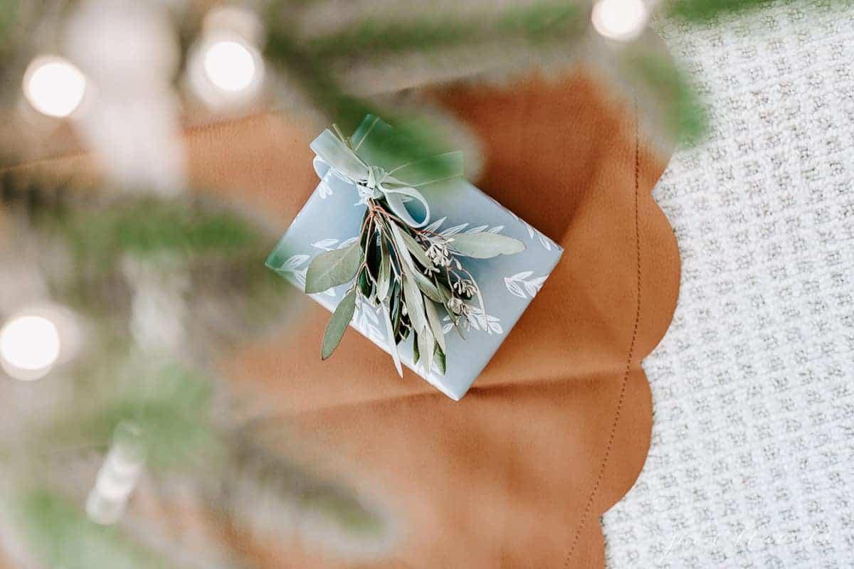 small present under tree on leather tree skirt