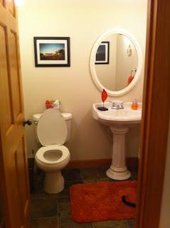A bathroom with white appliances and festive poinsettias.