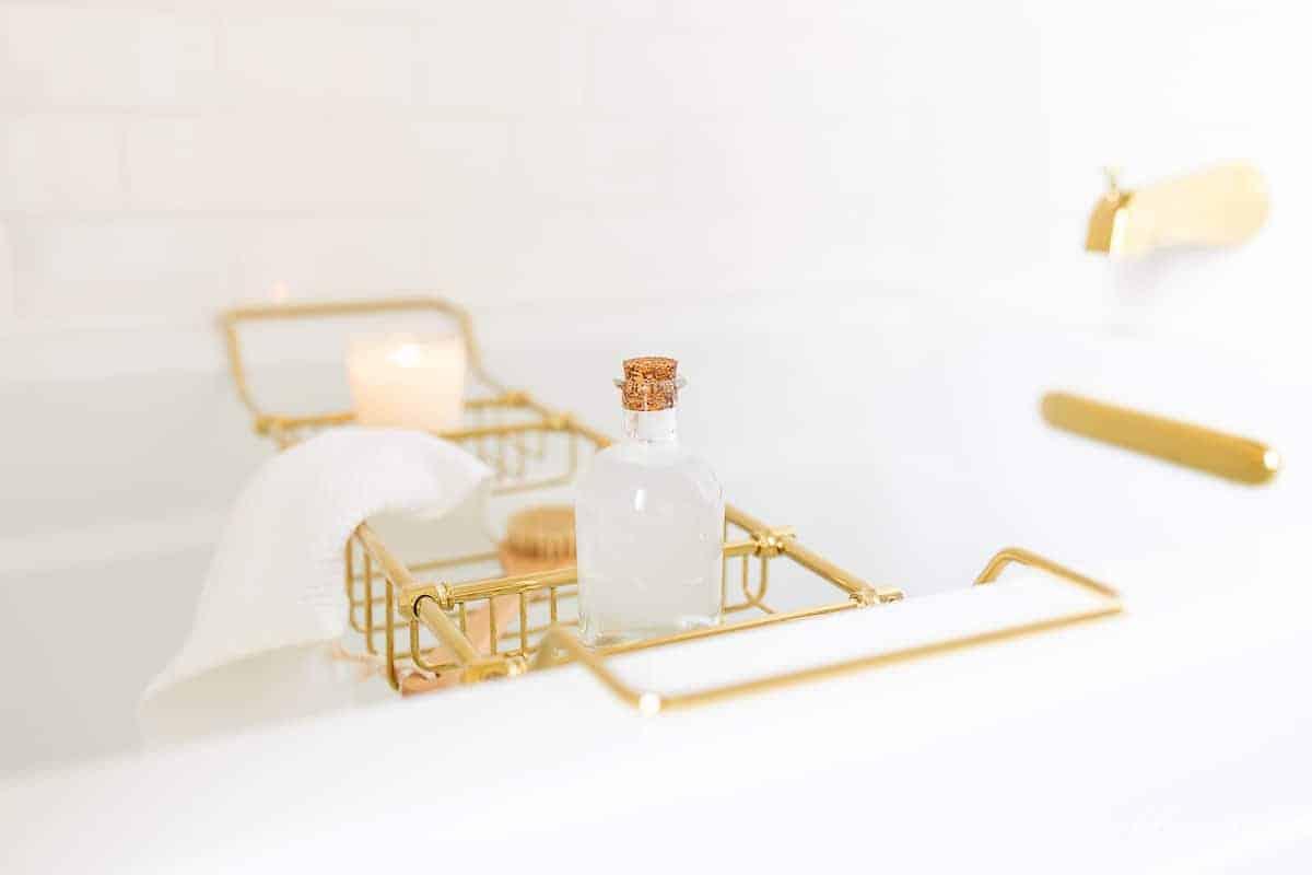 bath tub with brass bath tray