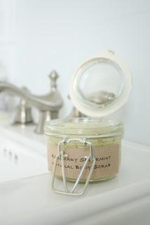 Rosemary body scrub in a glass jar.