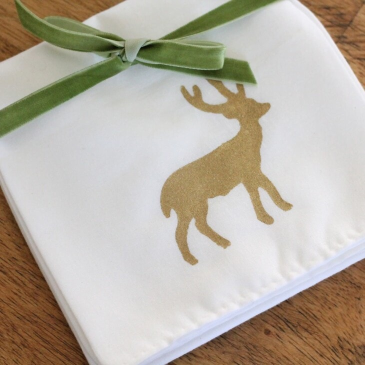 gold deer stenciled onto white hand towel