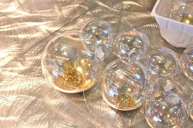 large craft ornament filled with gold glitter for the ornament garland