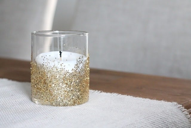 A candle dipped in gold glitter.