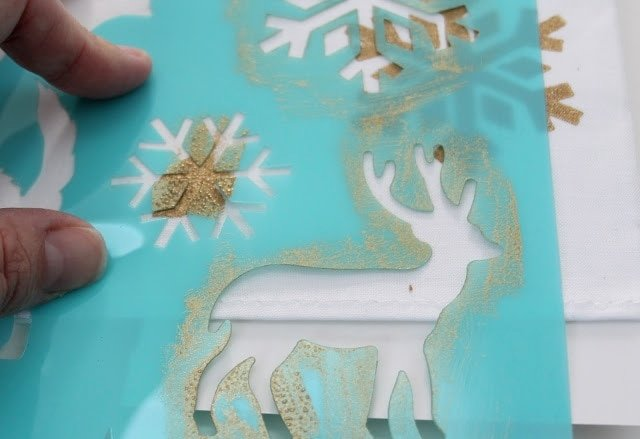 Gold spray painted snowflakes and deer on hand towels