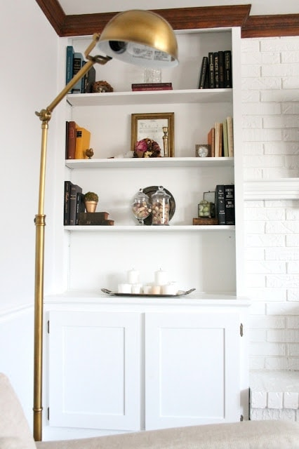 Shelves filled with books and other knick knacks.