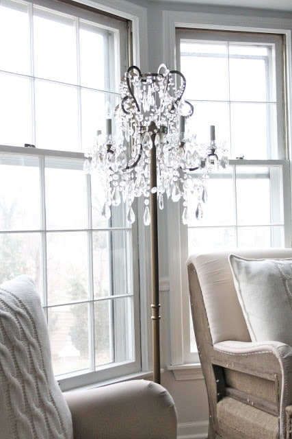 A chandelier next to a window
