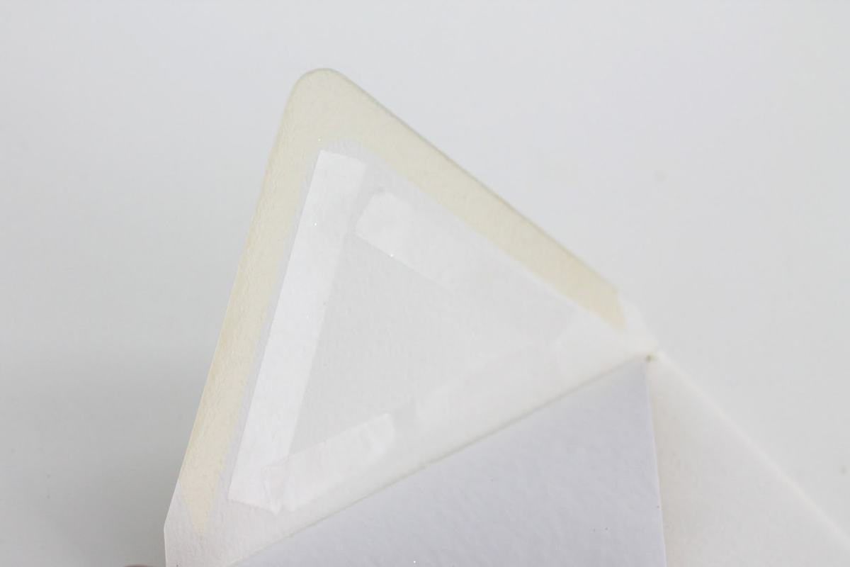 White envelope, inside flap lined with double stick tape