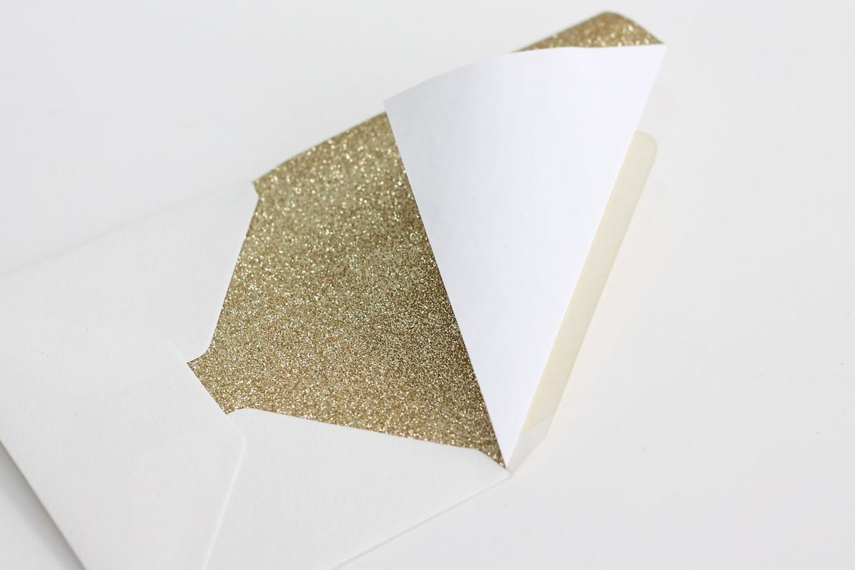 Gold glitter envelope liner, folded along top edge to make a point