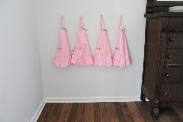 Pink aprons hanging on the wall