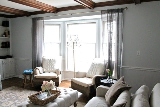 A living room filled with gray furniture and a large window