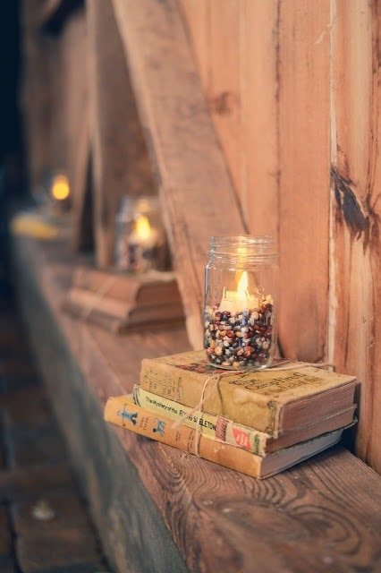 Stacked books with candles on top