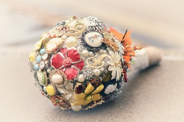A bouquet with flowers and pins in it.