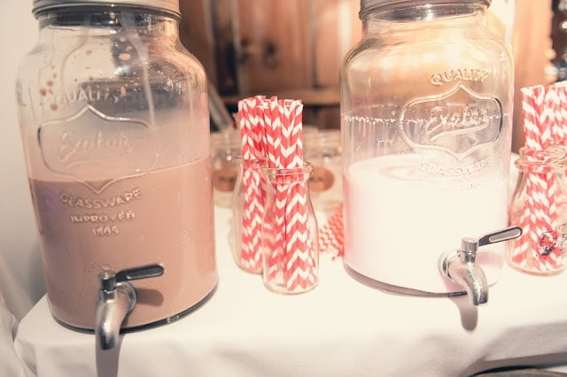 Chocolate and regular ilk with striped straws next to it.
