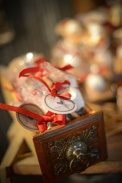Wedding favors tied with red ribbon