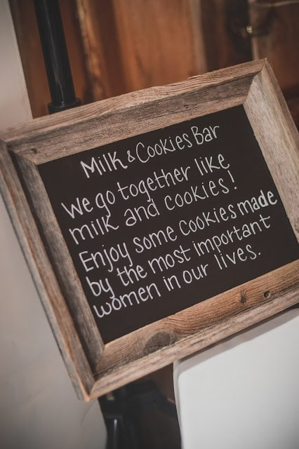 A close up of a sign about the Milk and Cookies bar.