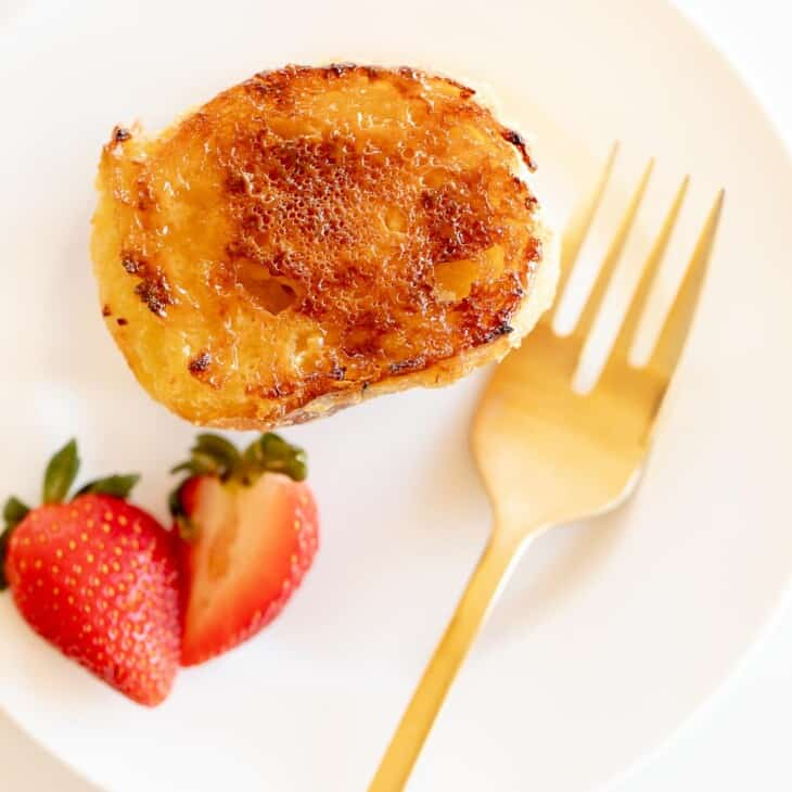 Crème Brûlée French Toast served with strawberries and gold fork