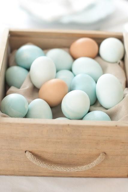A basket of multicolored eggs.