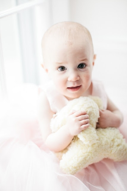 A baby holding a plush bunny