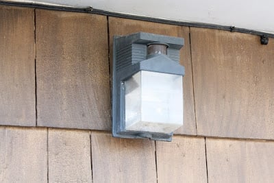 A gray, outdoor wall light.