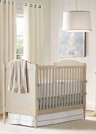 A nursery with a large window and a crib