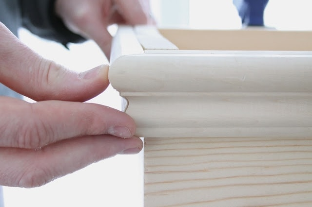 A wooden window box in the process of being made.
