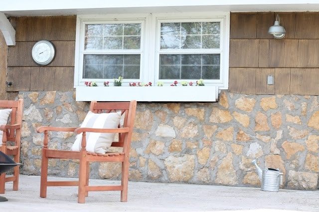 A chair sitting in front of a stone building