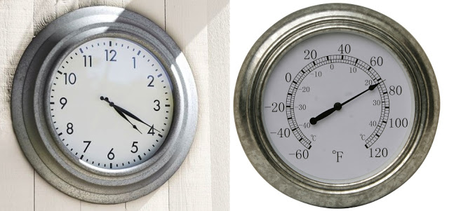 A close up of a clock and a thermometer