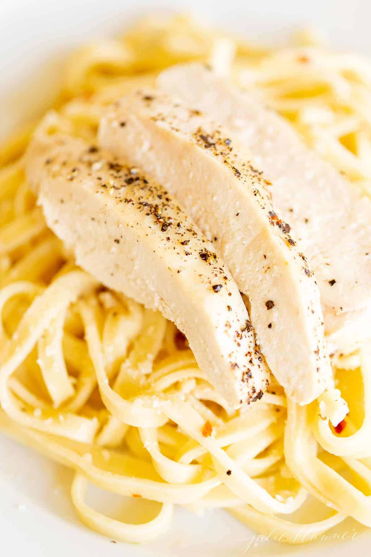 chicken on bed of pasta