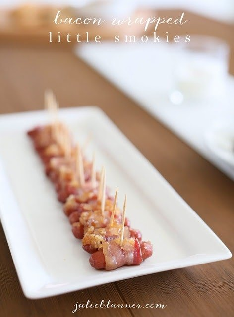 Brown sugar bacon wrapped little smokies on a white serving plate
