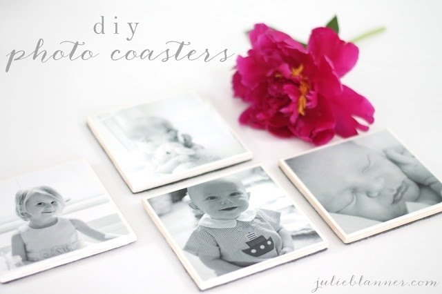 A close up of a flower next to photo coasters.