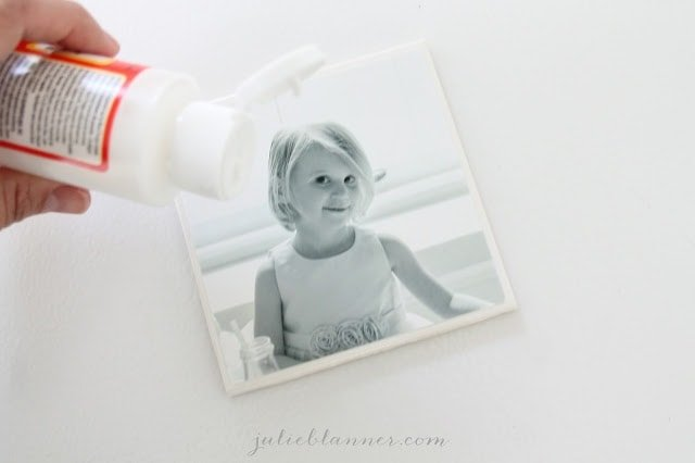 Photo coasters being mod podged