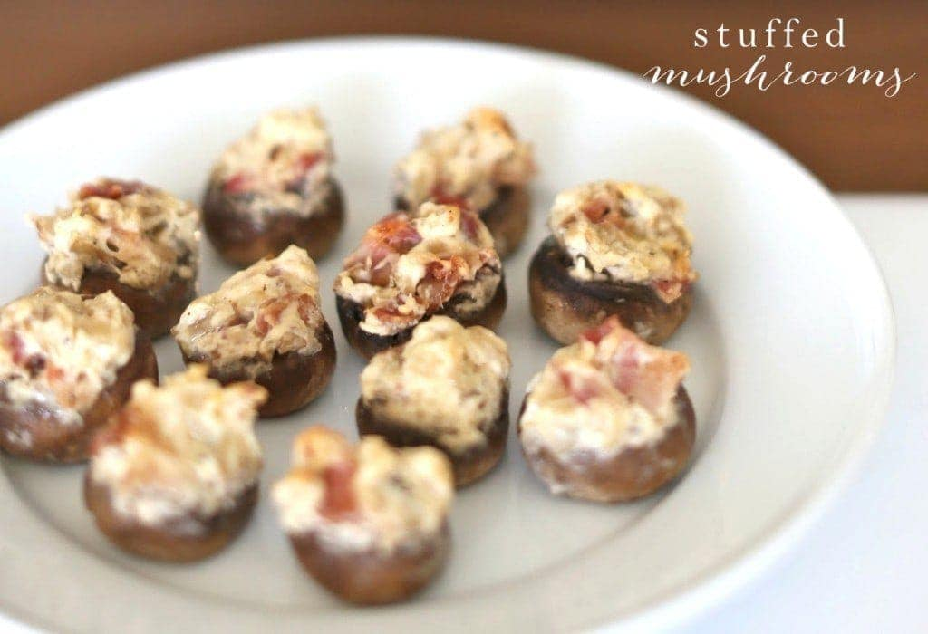 Close up of stuffed mushrooms on a serving plate