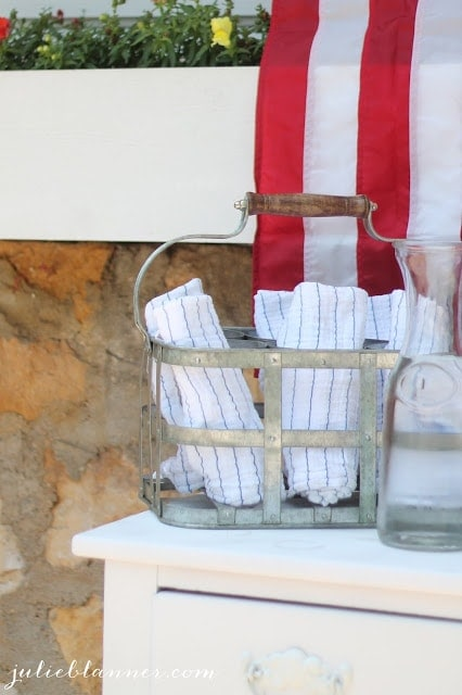 Navy and white striped towels in a towel holder.