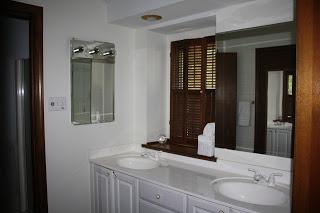 A wood and white bathroom.