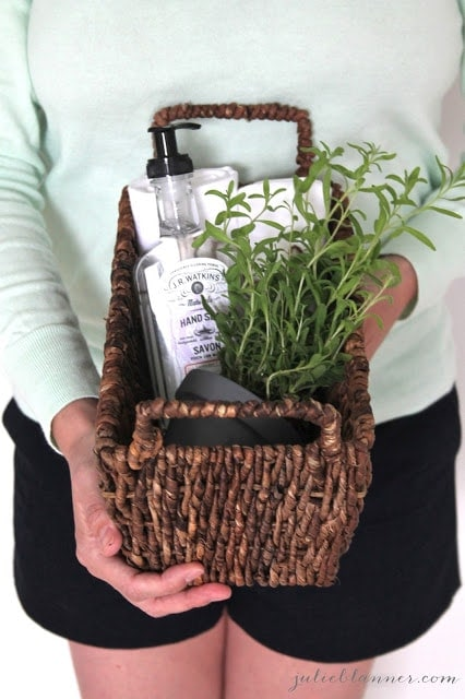 Bathroom or kitchen supplies in a woven basket.