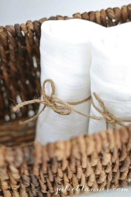 Towels wrapped in burlap string.