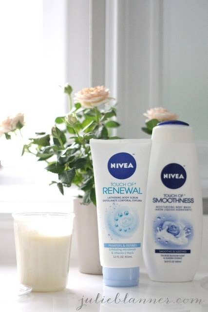 Nivea brand soap next to flowers and a candle.