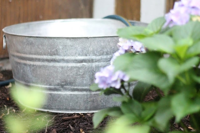 A bucket being filled with water.
