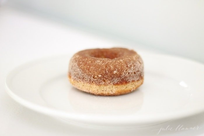 A baked doughnut on a white plate