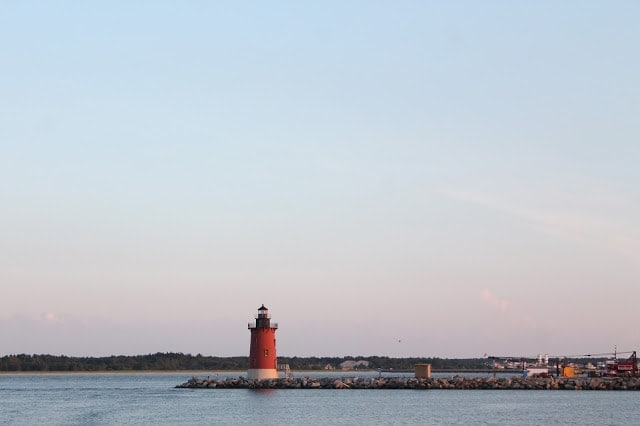 A lighthouse with a sunset behind it.